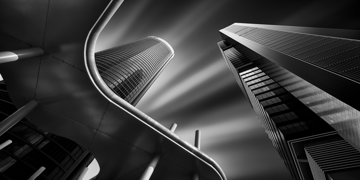 """Juan Lopez Ruiz of Spain is the winner of the 2020 Major Amateur category. His photo with the theme of """"Light and Dark on the Towers"""" features the Cuatro Torres financial complex in Madrid, Spain. The image finishes first in the Amateur Award's Built Environment/ Architecture category."""