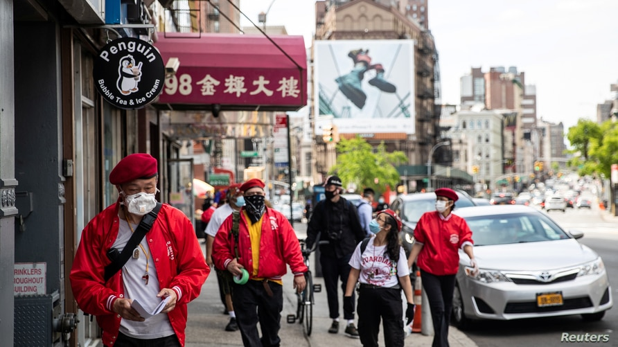 Wally Ng, a member of the Guardian Angels, patrols with other members in Chinatown in New York City, New York, U.S., May 16, 2020. Photo by Reuters.