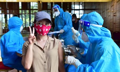 Expats vaccinated in Ho Chi Minh City thank Vietnam for kindness