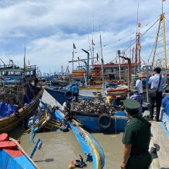 Nearly 100 fishing boats damaged as rains flood river in south-central Vietnam